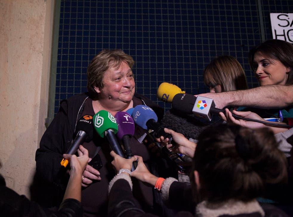 Teresa Mesa, center, spokesperson of Ebola patient Teresa Romero speaks to the media in front of the Carlos III Hospital in Madrid, Spain