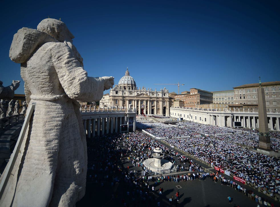 The faithful gather at a papal Mass for the beatification ceremony of Pope Paul VI at the Vatican
