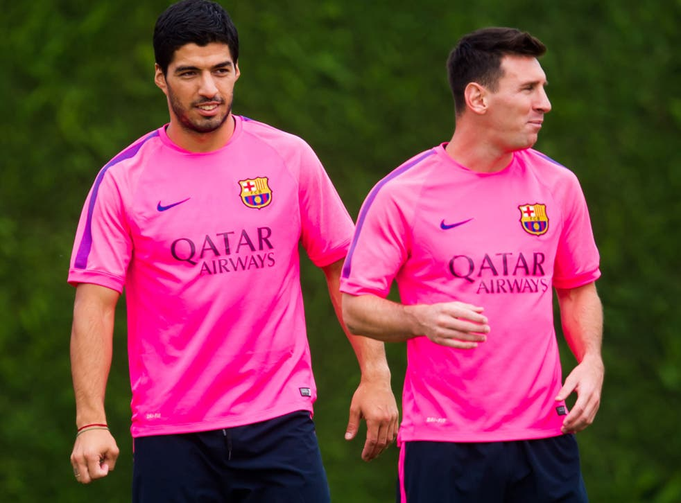 Luis Suarez and Lionel Messi during Barcelona training in August