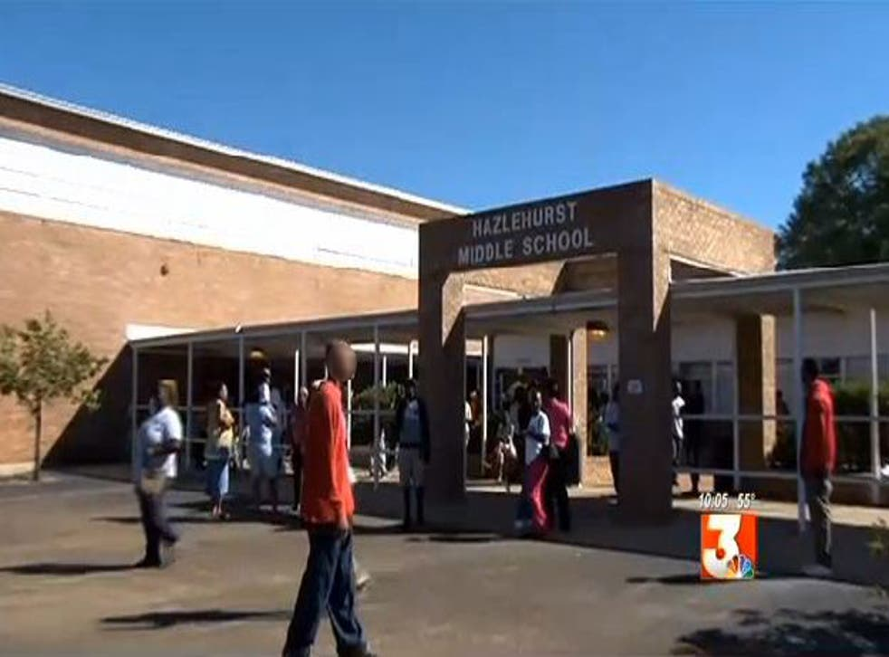 Hundreds of parents removed their children from a school in Mississippi after its principle returned from a trip to Africa