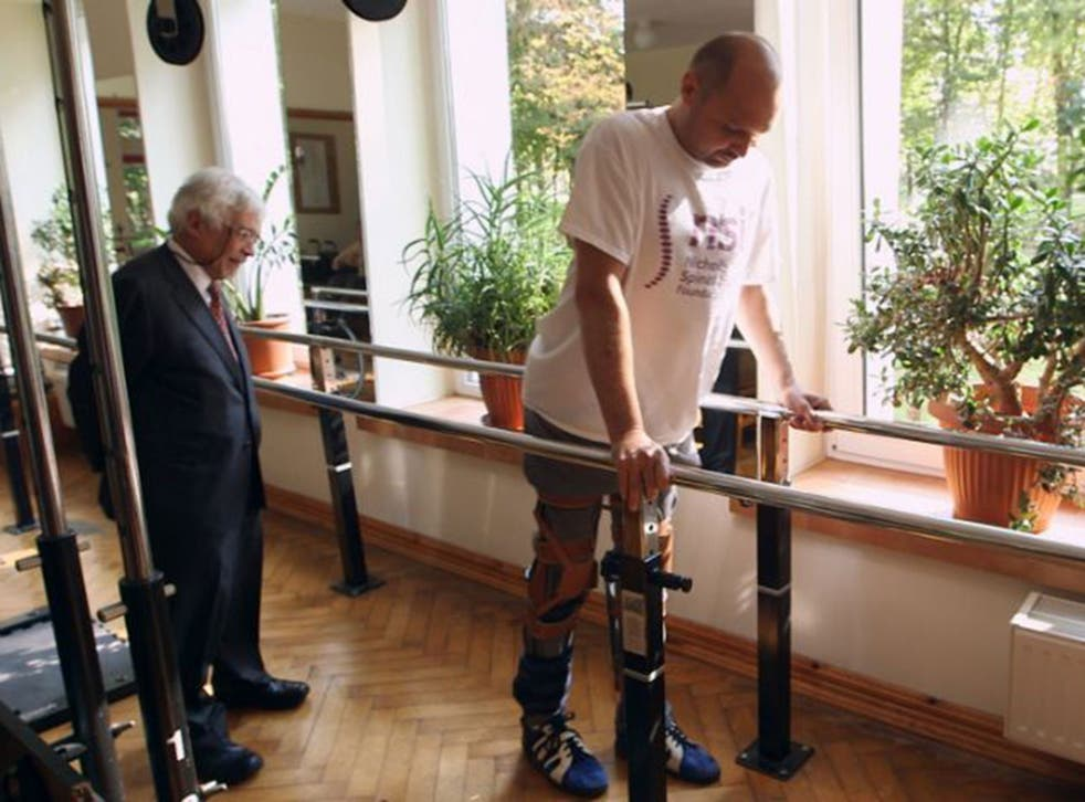 Professor Wagih El Masri, a consultant spinal injuries surgeon, with the patient Darek Fidyka