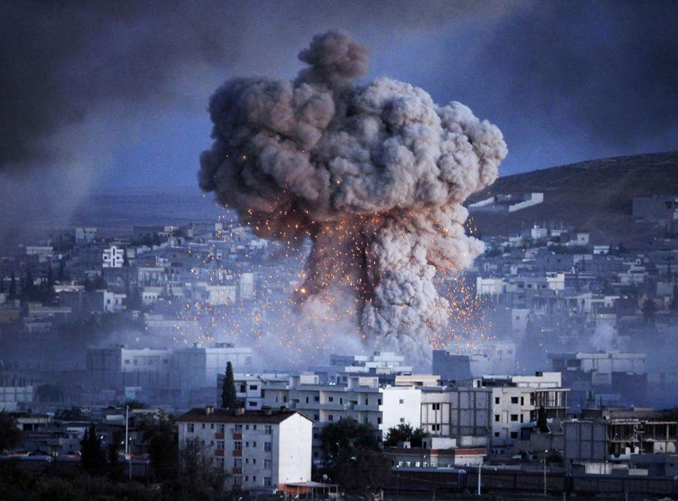 An explosion rocks the Syrian city of Kobani during a reported suicide car bomb attack by Isis on Monday (Getty)