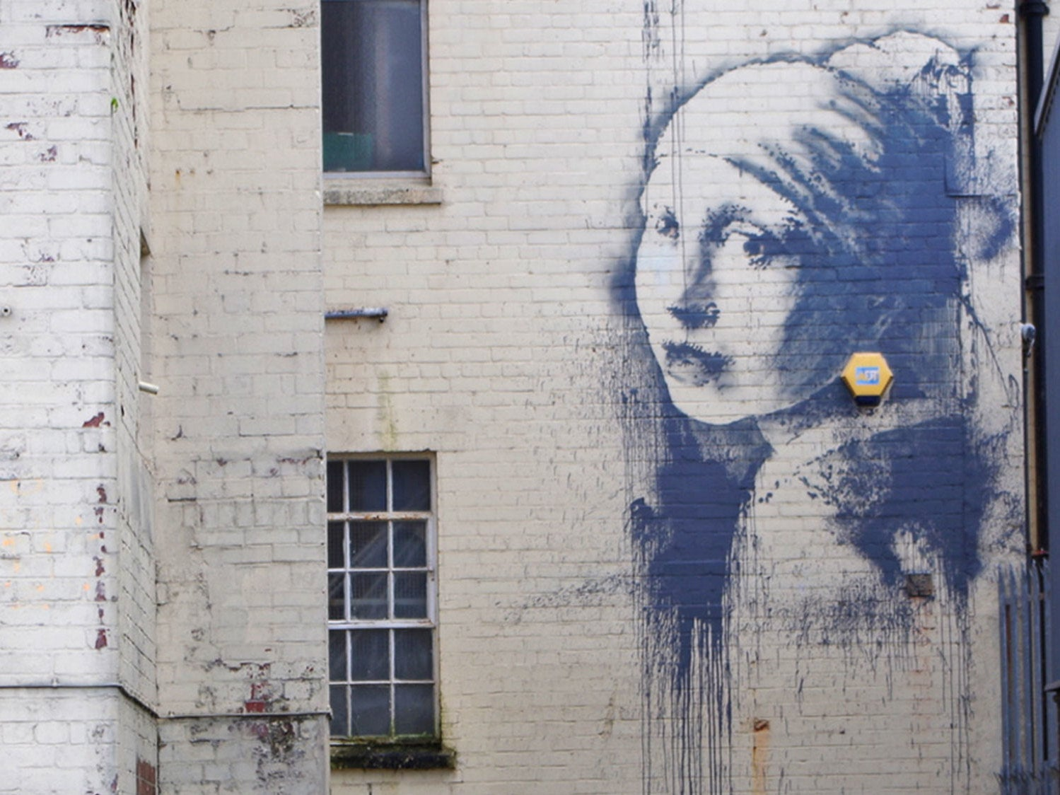 New banksy 39 girl with the pierced eardrum 39 appears in for Call for mural artists 2014