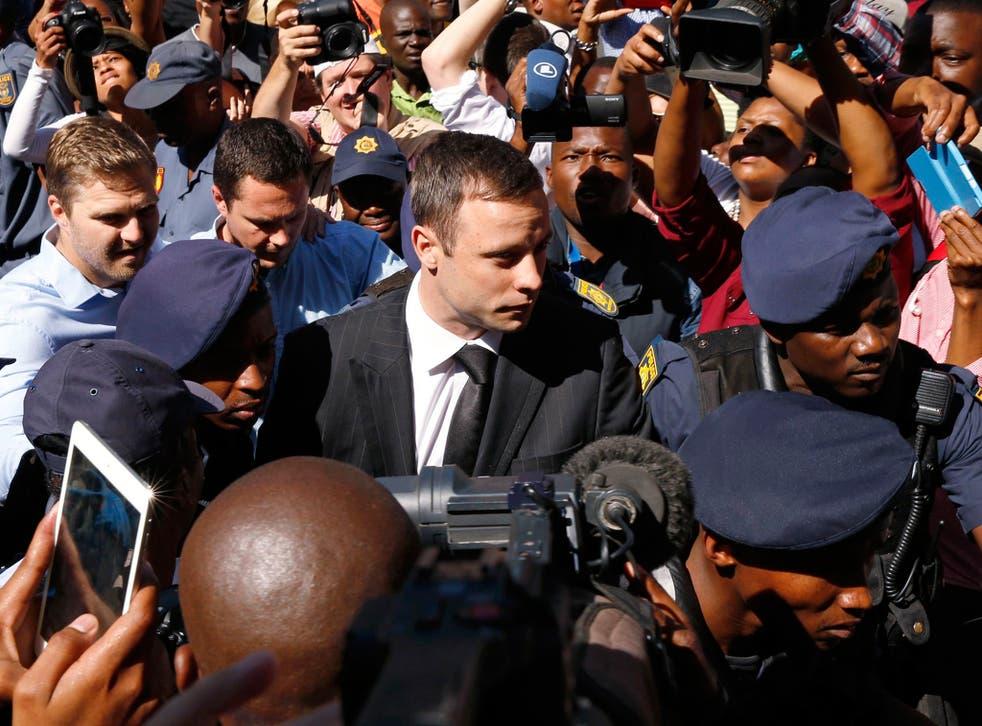 Oscar Pistorius arrives for his sentencing at the North Gauteng High Court in Pretoria