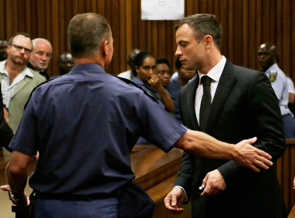 Oscar Pistorius is led out of court in Pretoria. Pistorius received a five-year prison sentence for culpable homicide by judge Thokozile Masipais for the killing of his girlfriend Reeva Steenkamp