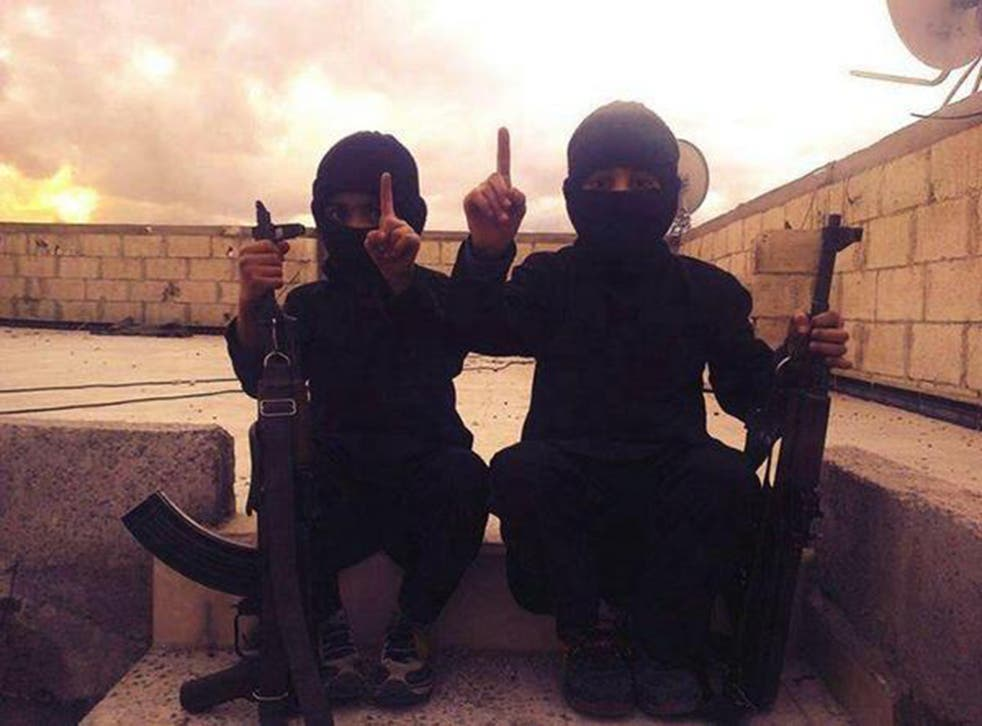 An image posted on 21 October by an Isis-linked Twitter feed, with a caption in Arabic calling these children 'new graduates of Jihad School'