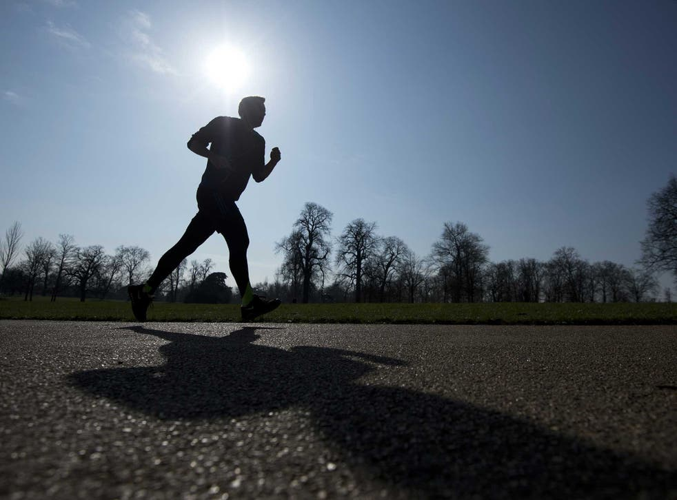 A man runs through Kensington Park Gardens as Londoners wake up to a week of sunshine last month