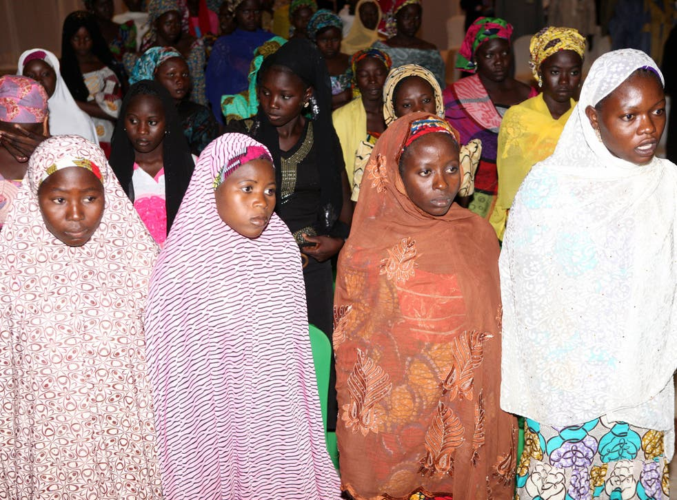 Some of the Chibok schoolgirls who escaped their Boko Haram Islamist captors wait to meet the Nigerian president at the presidency in Abuja on July 22, 2014.