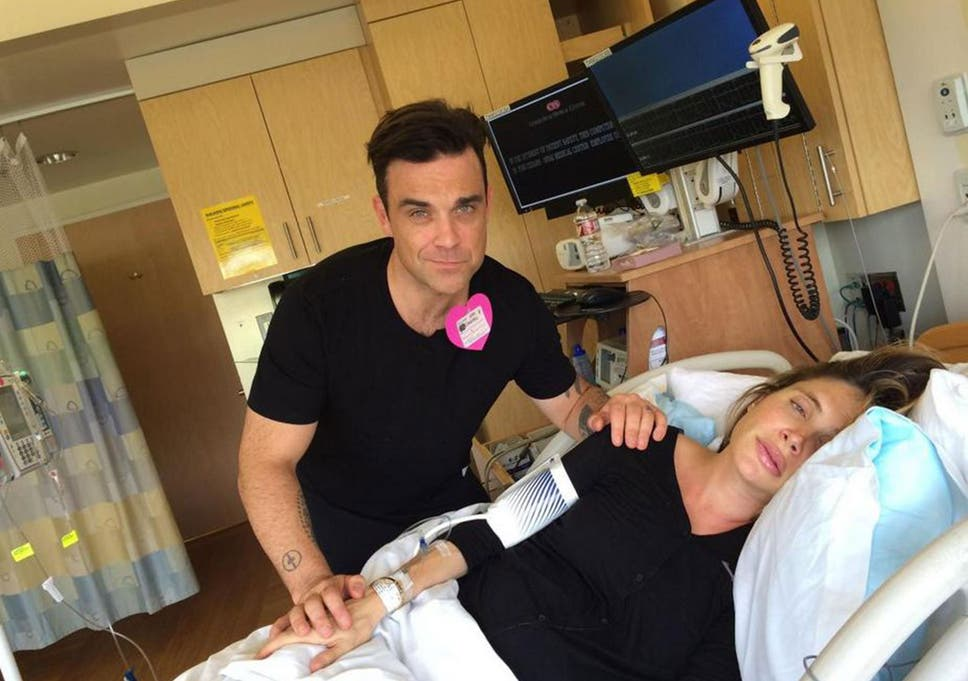 Because if there's just one thing more painful than vaginal delivery, it's  got to be listening to Robbie Williams singing Frozen while you push