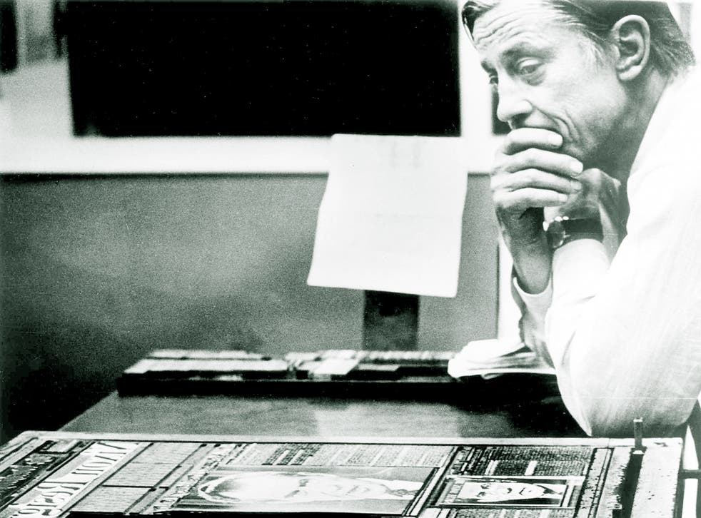 Ben Bradlee in the composing room of The Washington Post in 1974, looking at A1 of the first edition of the newspaper, headlined 'Nixon Resigns'.