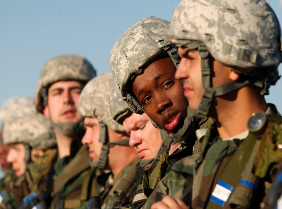FILE IMAGE: A US Army recruit looks at his 'battle buddy' during basic training at the Fort Sill Army Post in Fort Sill, Oklahoma November 5, 2009
