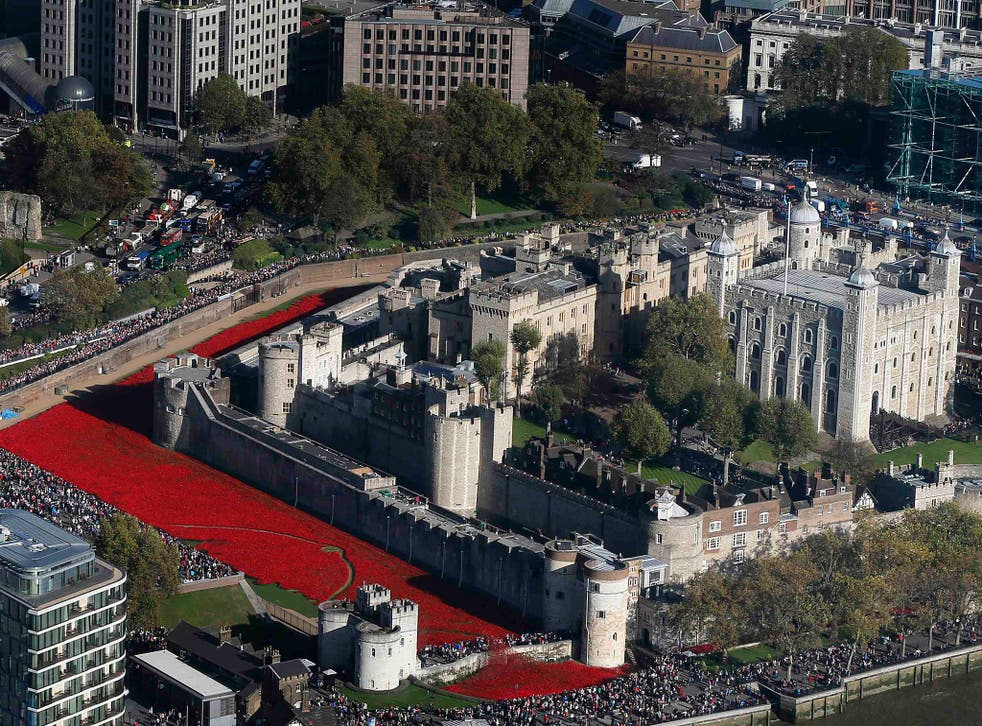 """Red ceramic poppies that form part of the art installation """"Blood Swept Lands and Seas of Red"""" are seen at the Tower of London in London. The evolving art installation, which will be completed on 11 November, will create a commemoration for the centenary"""