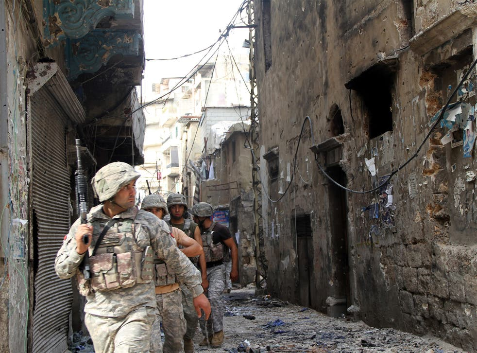 Lebanese soldiers patrol in the Bab al-Tabbaneh area of Tripoli