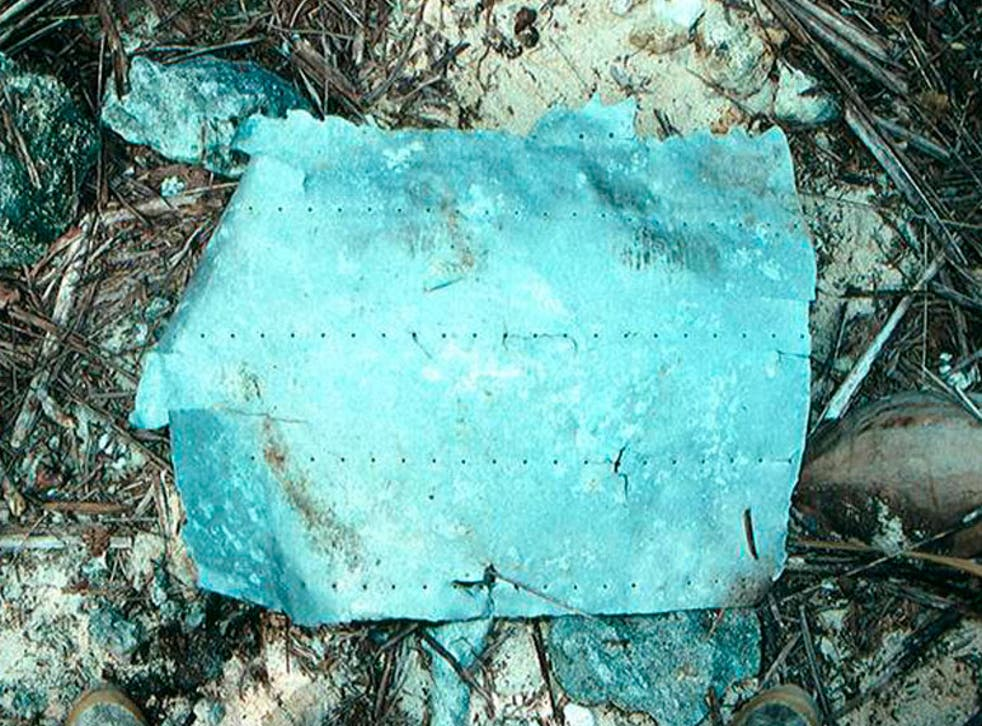 This warped piece of metal was uncovered on a 1991 voyage to the island of Nikumaroro in the Republic of Kiribati by TIGHAR, which has spent millions of dollars searching for Amelia Earhart's plane in a project that has involved hundreds of people.