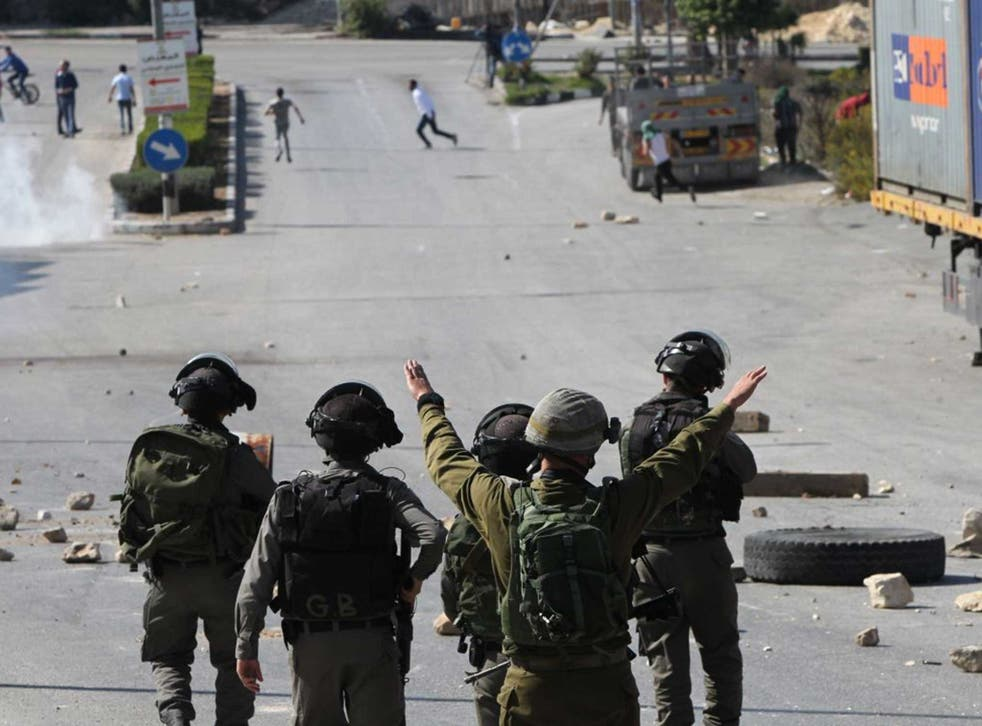 IDF soldiers clear a street during a Palestinian demonstration last week