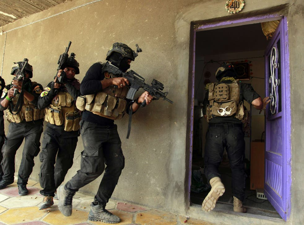 Iraqi special forces search a house yesterday after retaking Jurf al-Sakhar, north of the Shia shrine at Karbala