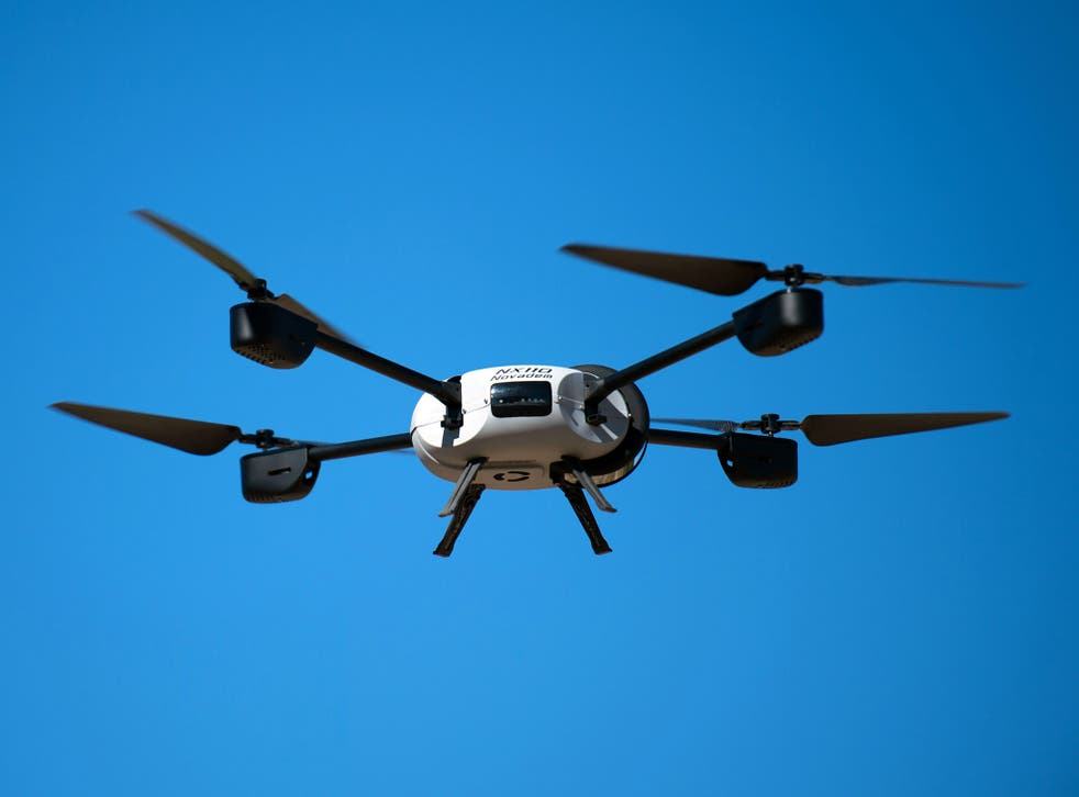 A Novadem NX 110 drone flies during a presentaion at a firefighter rescue centre in Les Pennes-Mirabeau, southern France, on August 28, 2014.