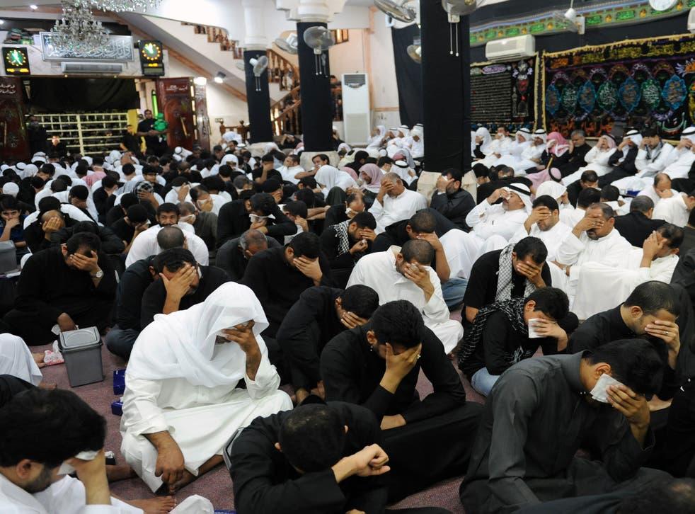 Saudi Shia Muslim men mourn during the commemoration of Ashura on 25 November, 2012, in the eastern province of Qatif