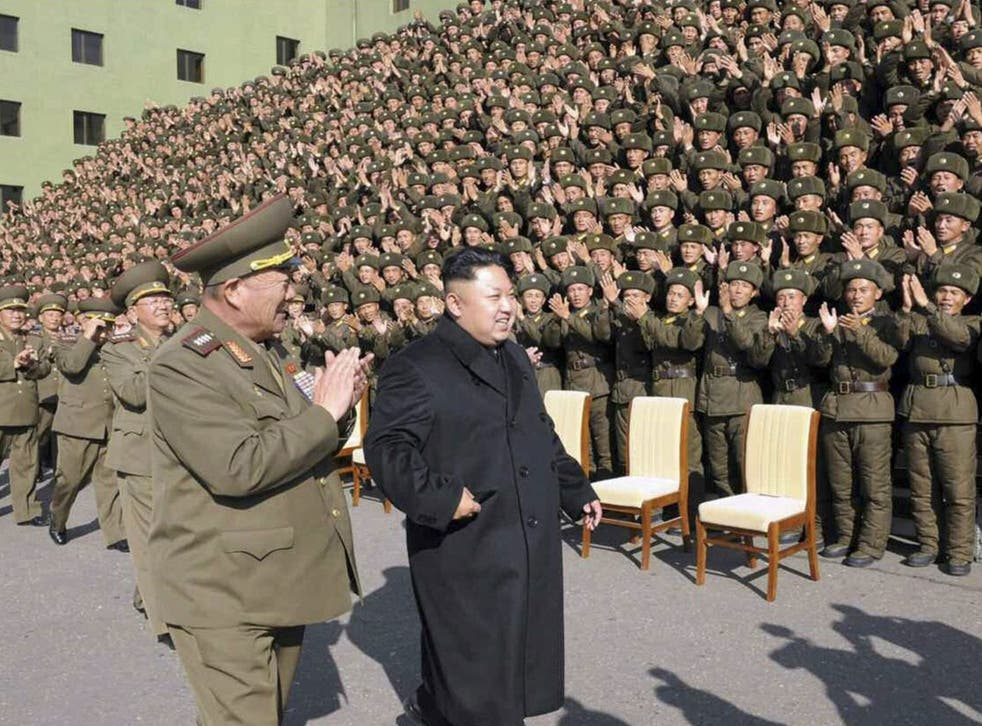 Spot the women: File photo from KCNA on 5 November 2014 shows North Korean leader Kim Jong-un attending an event with military commanders