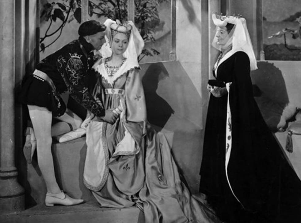 Actors Laurence Olivier Renee Asherson and Ivy St Helier in a scene from the Laurence Olivier production of Shakespeare's Henry V