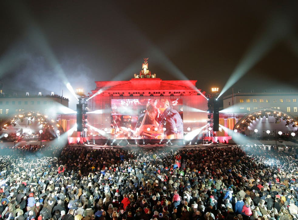 Huge crowds gather for an open-air party at Brandenburg Gate