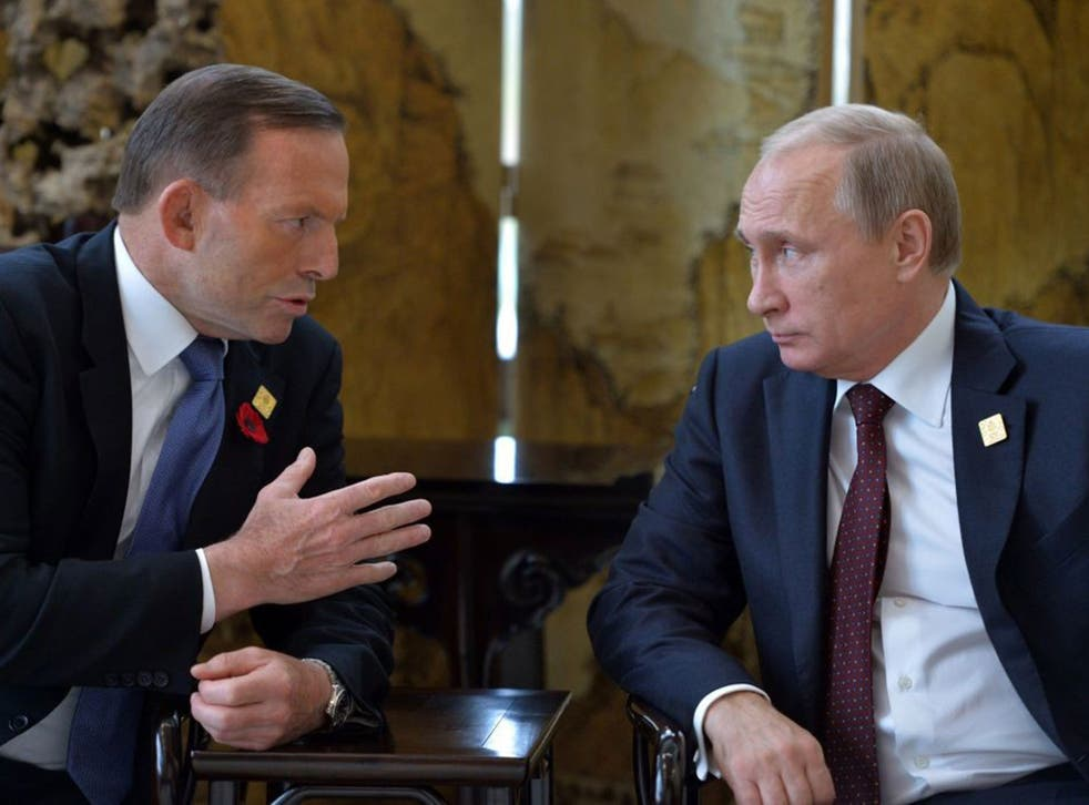 Russian President Vladimir Putin, right, and Australian Prime Minister Tony Abbott talk on the sidelines of the Asia-Pacific Economic Cooperation (APEC) Summit in Beijing