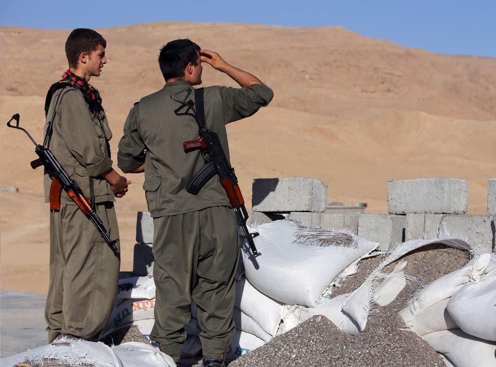 PKK fighters guard a post against Isis near Irbil, the capital of the autonomous Kurdish region in northern Iraq