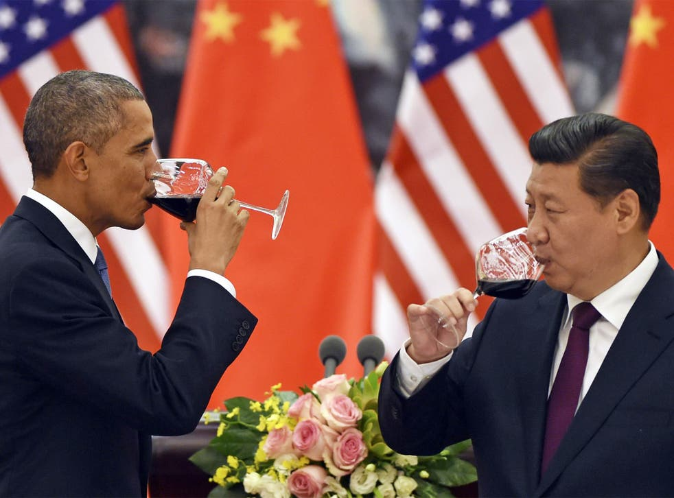 US President Barack Obama and Chinese President Xi Jinping have a drink after agreeing a deal on carbon emissions