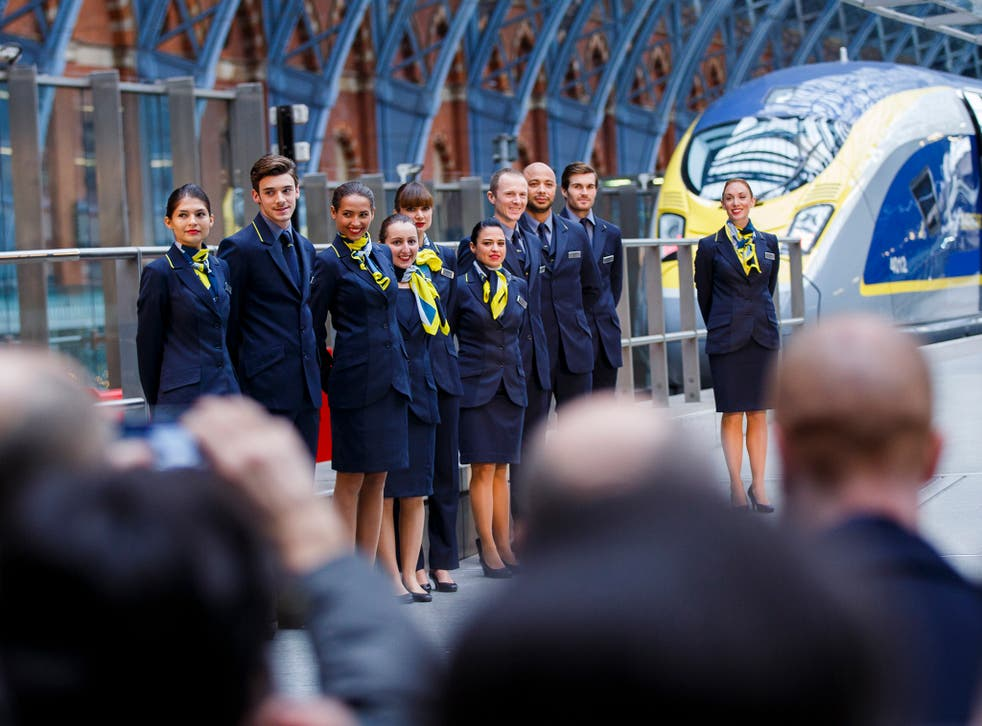 Members of Eurostar staff attend the unveiling Eurostar's brand new e320 fleet today complete with a live reveal of the train and special guests including Raymond Blanc and a catwalk show with 20 Eurostar staff at St Pancras Station on November 13, 2014 i