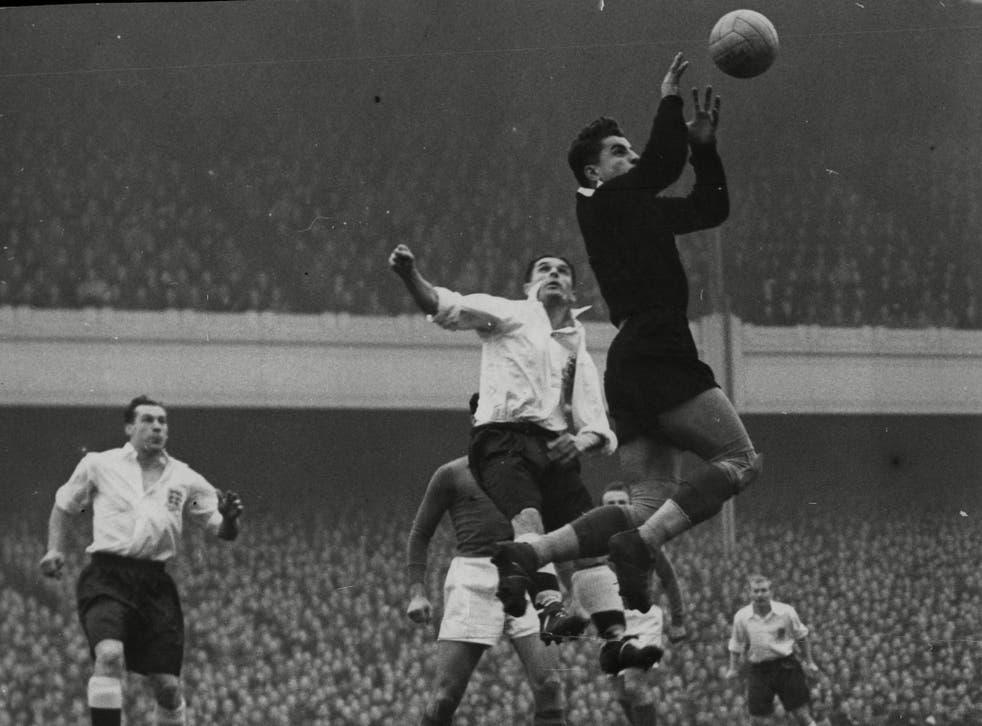 Vladimir Beara, the Yugoslavian goalkeeper saving from England's Nat Lofthouse