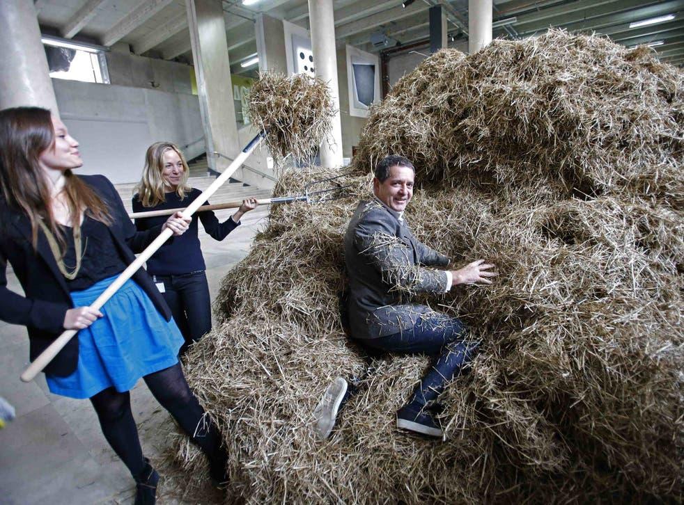 Italian artist Sven Sachsalber sifts through a haystack