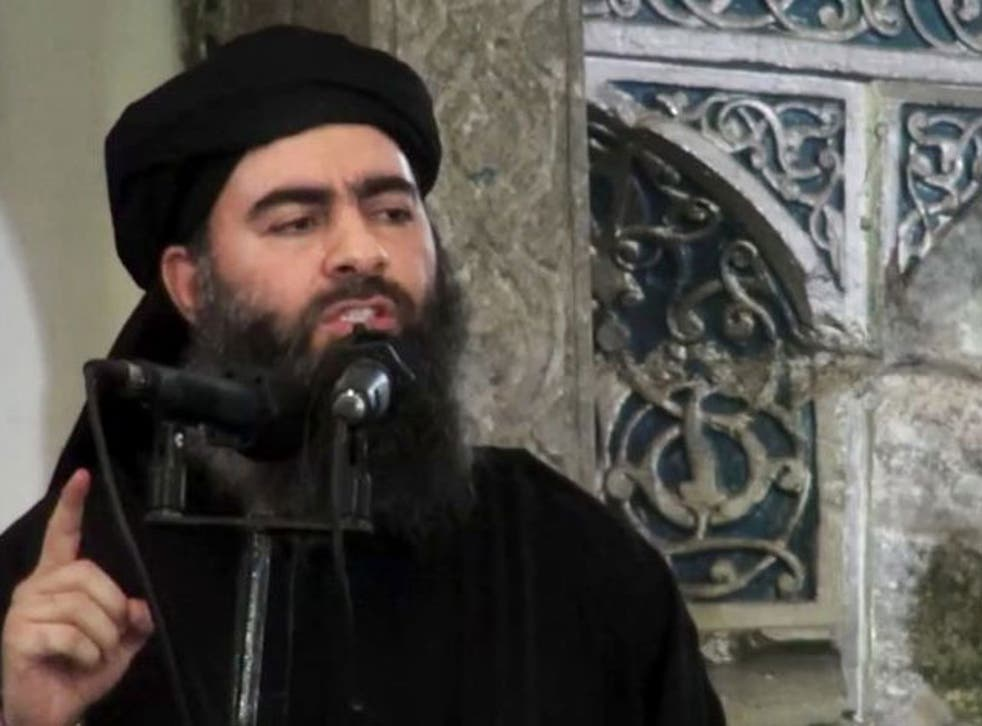 The leader of the Islamic State group, Abu Bakr al-Baghdadi, delivering a sermon at a mosque in Iraq.