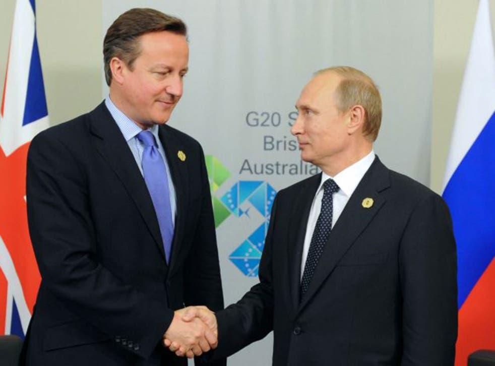 David Cameron and Vladimir Putin shake hands at the G20 in Brisbane