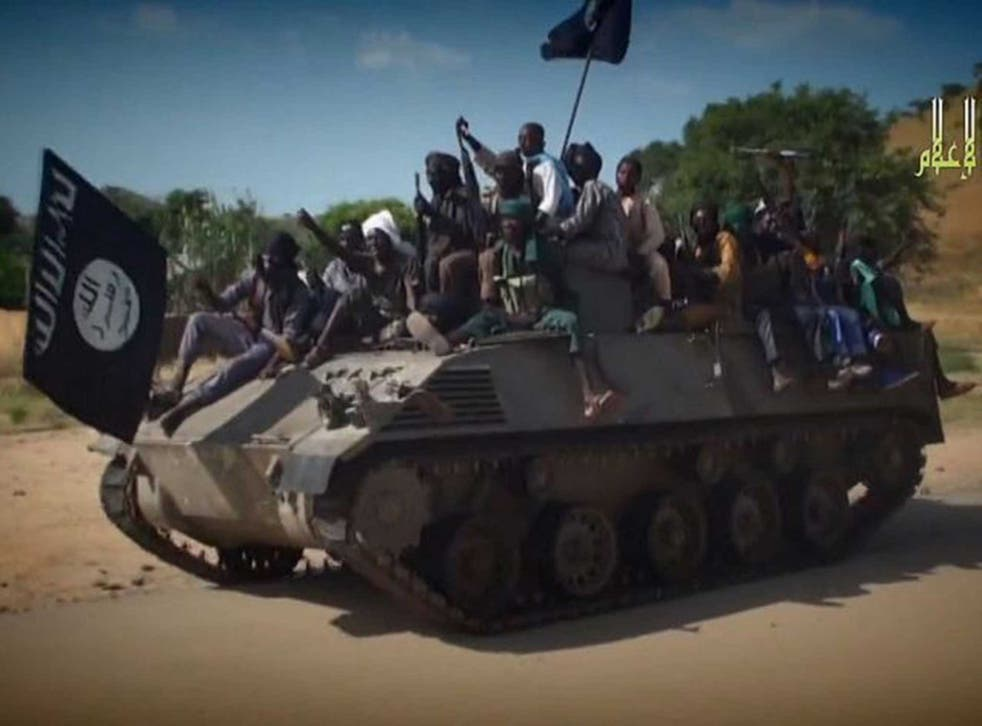 Boko Haram militants ride on a tank: the group has just captured the town of Chibok