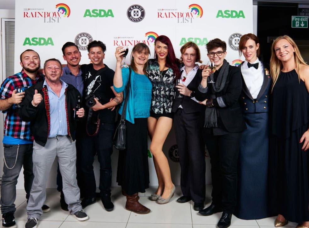 Cause to celebrate: Partygoers including Lewis Rimmer (second left), Fox Fisher (fourth left), Paris Lees (fifth from right) and CN Lester (third from right)