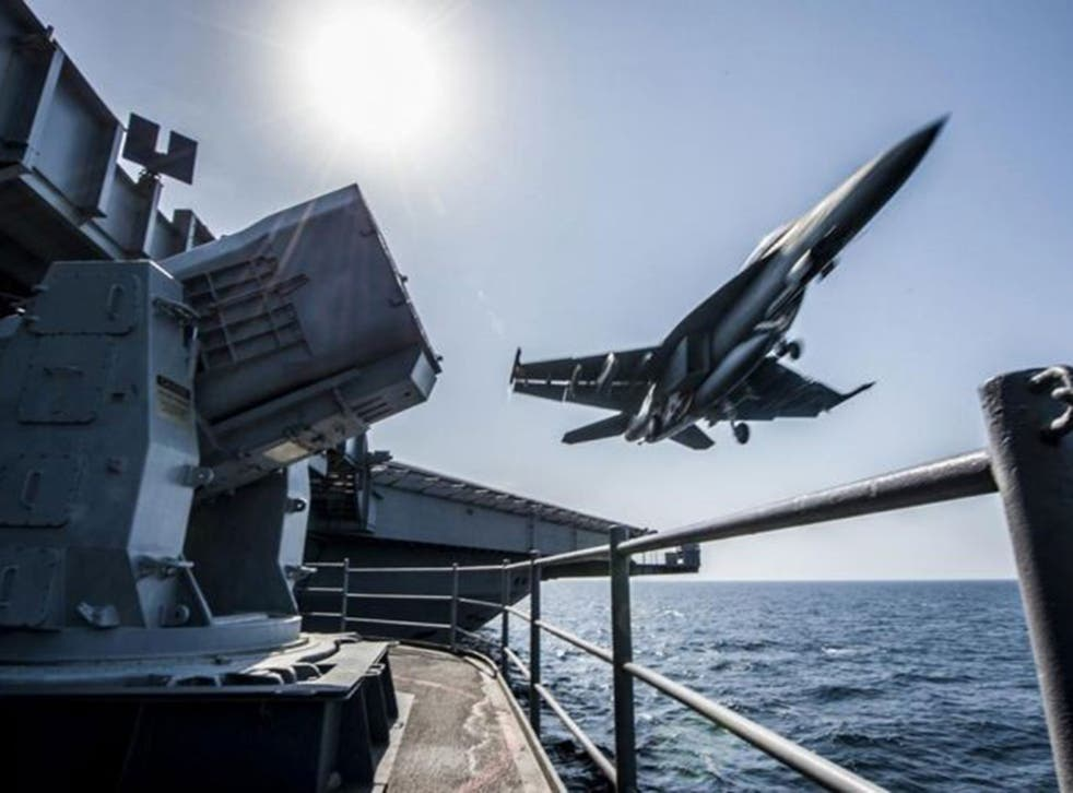A fighter  jet takes off from a US  war ship