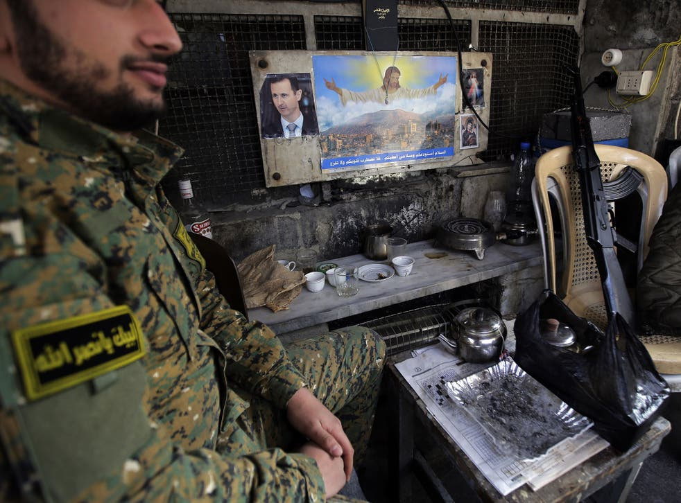 A member of Syria's National Defence Force, a militia which has united some Muslim and Christian tribes in the fight against Isis