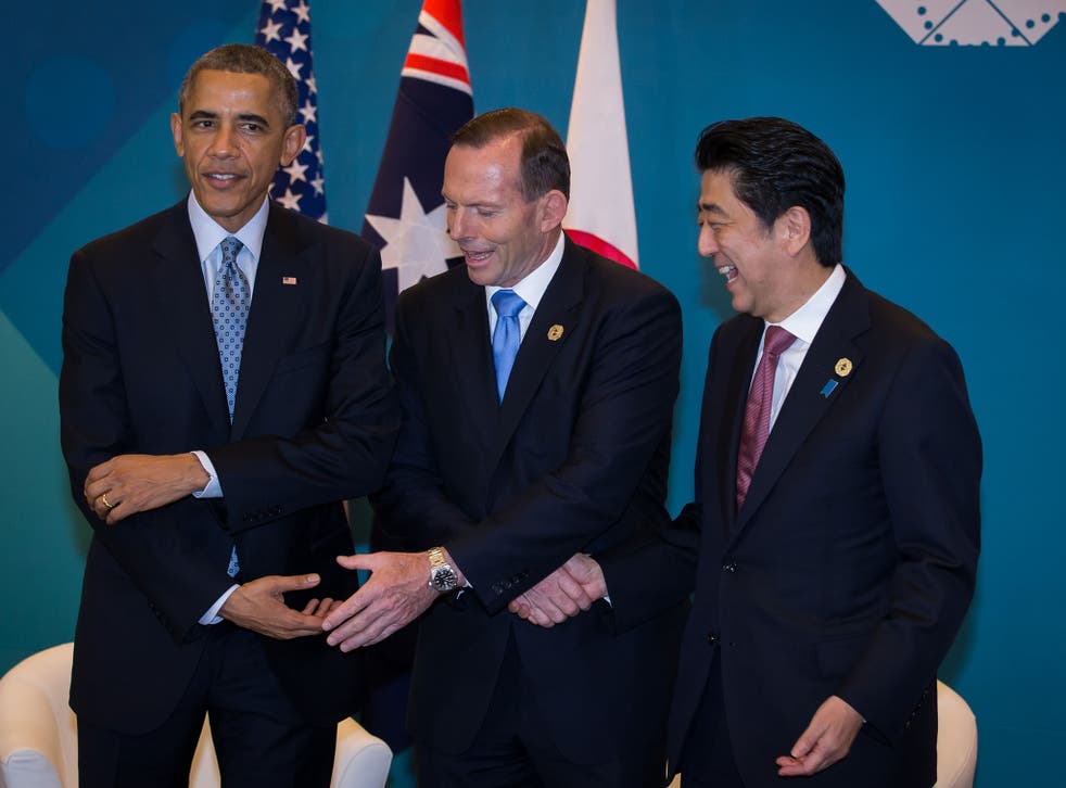 President Barack Obama, Australian Prime Minister Tony Abbott, and Japan's Prime Minister Shinzo Abe meet during a trilateral meeting at the G20 Summit