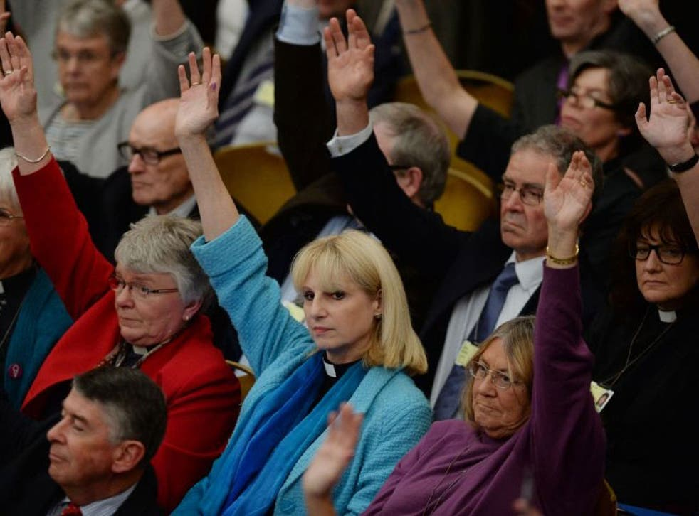 Clergy cast votes in favour of women Bishops at the Anglican General Synod in Church House, London, allowing women to become bishops for the first time.