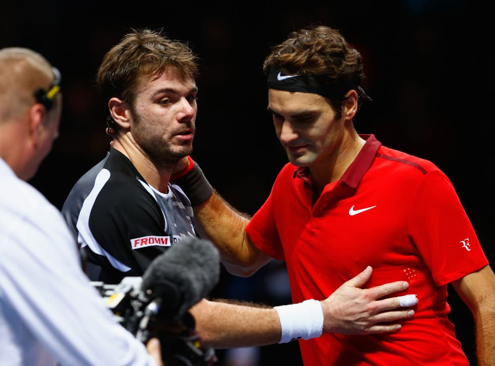 Stan Wawrinka and Roger Federer, right, at the net straight after their three-set semi-final at the O2 Arena in London, when Federer won after saving four match points