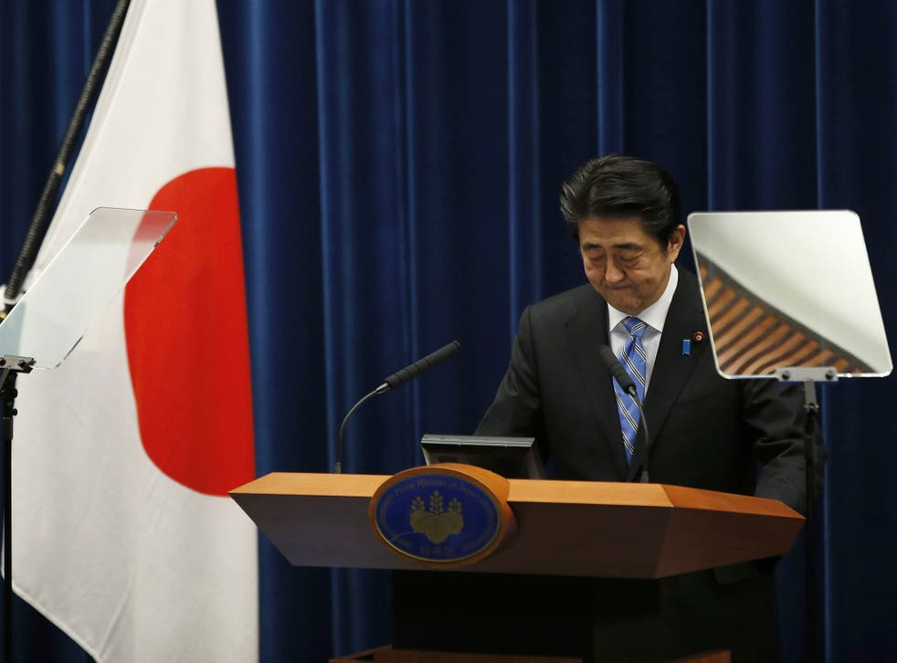 Japan's Prime Minister Shinzo Abe attends a news conference at his official residence in Tokyo November 18, 2014