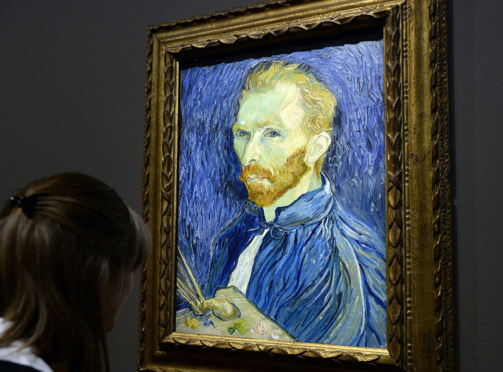 A visitor looks at a self-portrait by Vincent Van Gogh displayed at the Orsay Museum as part of the exhibition 'Van Gogh/Artaud. The Man Suicided by Society', on 10 March, 2014, in Paris