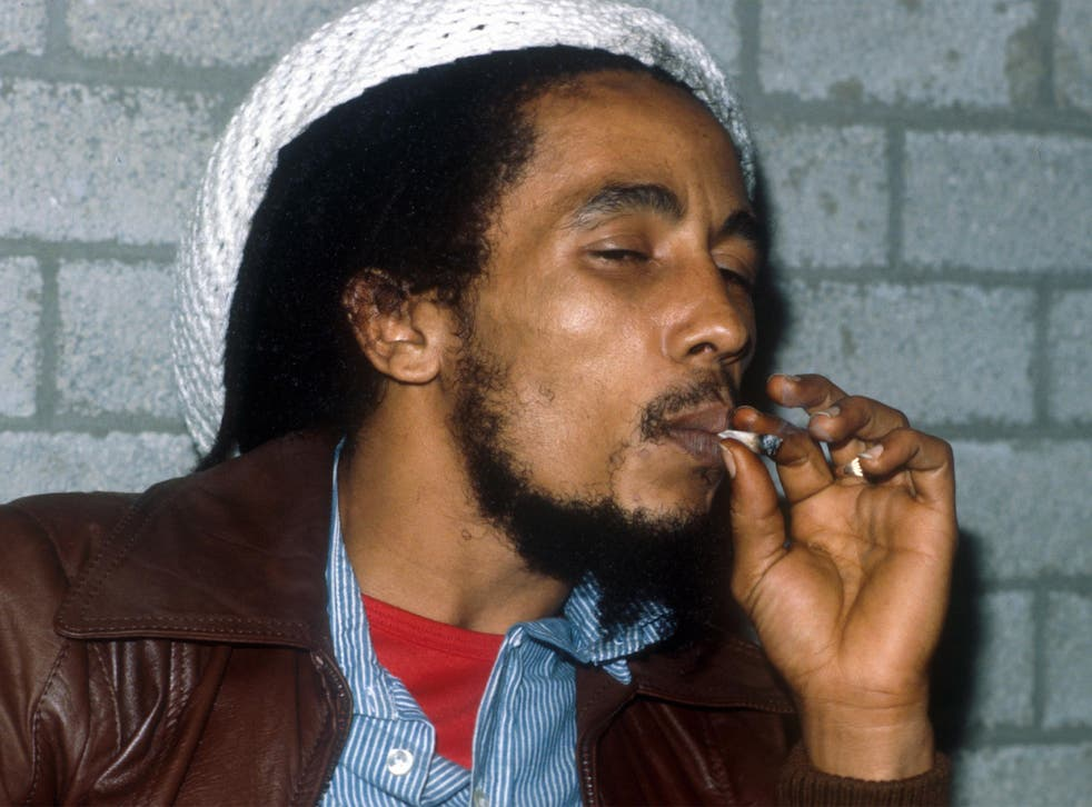 Bob Marley smoking a joint backstage before a gig in Rotterdam