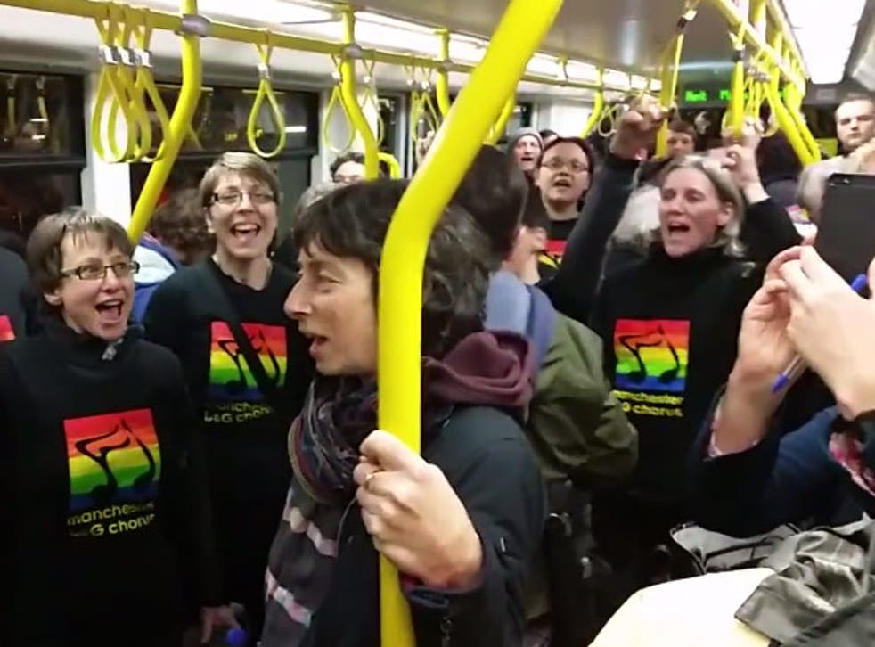 Members of Manchester Gay and Lesbian Chorus sing on a tram in solidarity with two victims of a homophobic attack