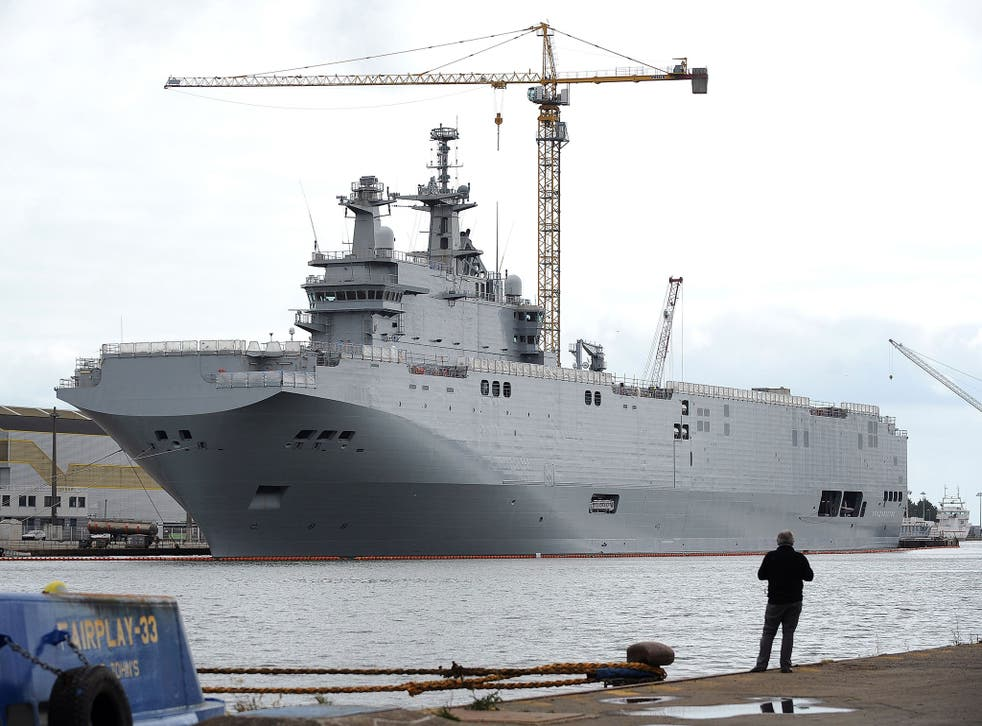 File image taken on 9 May, 2014 in Saint-Nazaire shows the Vladivostok warship, a Mistral class helicopter carrier ordered by Russia