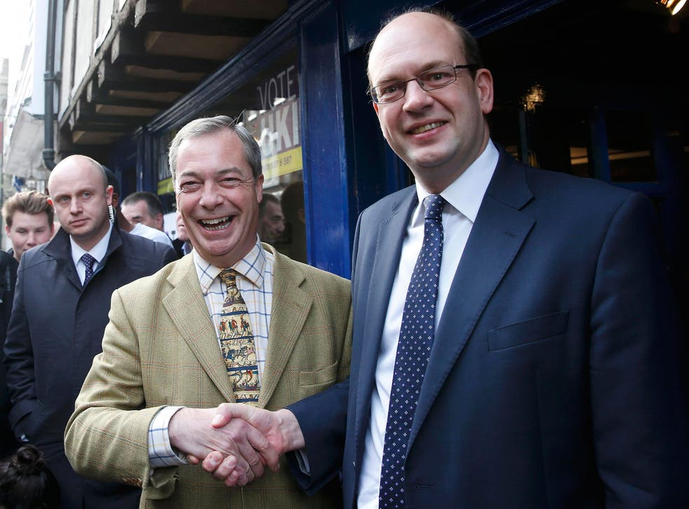 Nigel Farage shakes hands with Mark Reckless, the former Conservative Party member of Parliament for Rochester and Strood, on polling day