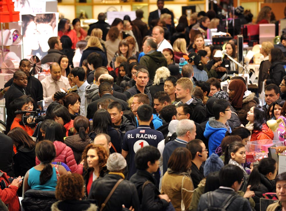 People crowd the first floor of Macy's department store as they open at midnight (0500 GMT) on November 23, 2012 in New York to start the stores' 'Black Friday' shopping weekend.
