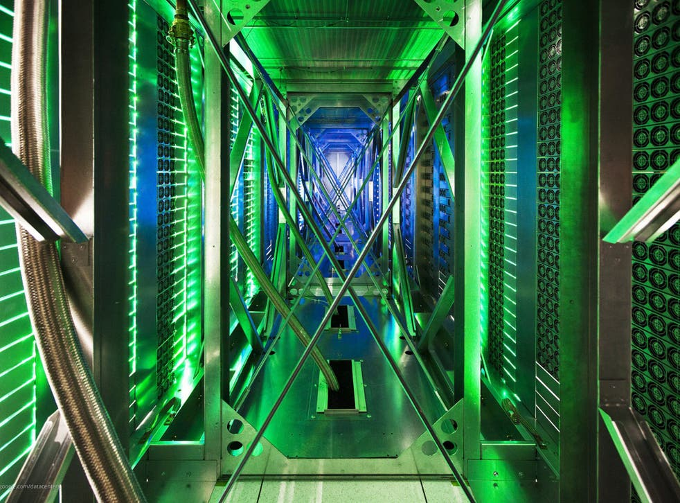 An undated handout photo provided by Google on 19 October 2012 shows hundreds of fans funnelling hot air from the server racks into a cooling unit to be recirculated in the Google data center in Pryor, Oklahoma.