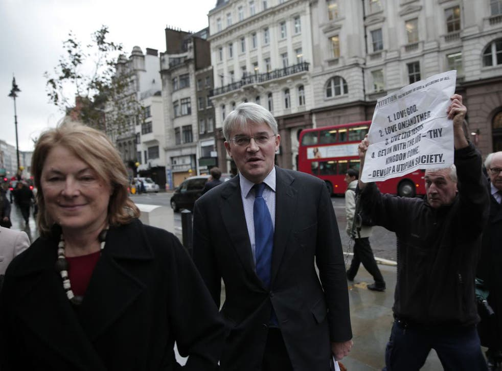 Andrew Mitchell, accompanied by his wife Sharon, arrives at the Royal Courts of Justice in London this week (AP)