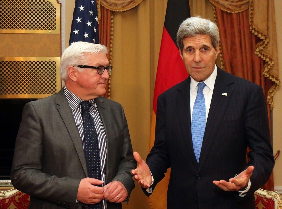 Frank-Walter Steinmeier, left, and John Kerry in Vienna